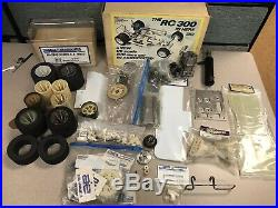 Vintage 1/8 Associated RC300 BD car lot + parts new & used parma celica body