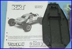 Vintage Losi XXT stadium truck unbuild kit witho body tyres