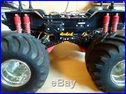 Vintage Tamiya Clodbuster Rolling Chassis. Chrome Wheels good tires. Nice shape
