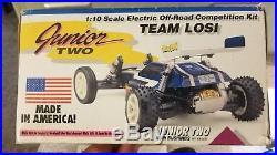 Vintage Team losi Junior 2 with Losi revolution motor and orig. Box. BOX ART